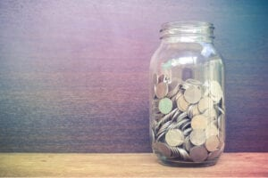 Jar of coins. Has Coronvirus affected your saving habits?