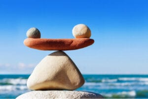 Stones balancing. Balancing different retirement goals